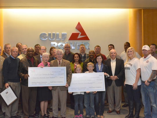 Gulf Power presented donations for more than $31,700 each to Gulf Coast Veterans in Need and Building Homes for Veterans. The funds were raised through Gulf Power's Clay Shoot for America's Heroes in November.