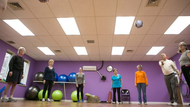 Reporter Jen Rini in this week's Take It Off class at Beyond Fifty Fitness, an over 50 gym that has a flexibility and balance class that improves the range of joint motion and muscles.