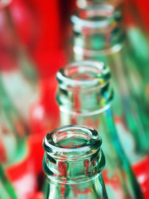 A Genesee County man pleaded guilty in Livingston County Circuit Court to trying to return more than 10,000 nonreturnable bottles in Michigan.