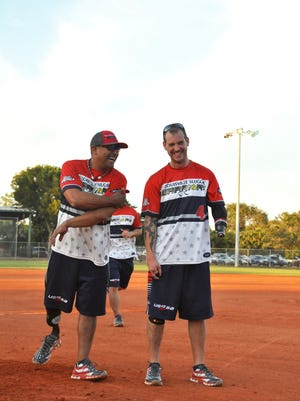 Louisville Slugger Warriors players Carlo Adame and Matt Kinsey share a laugh before the First Responders-Warriors Cup softball tournament at Veterans Field on Nov. 11.