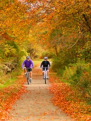 Riding through fall foliage in Haley Farm State Park in Groton, CT.
