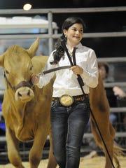 Brianna Blocker, 11, shows her winning 810-pound heifer.