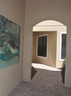 One of the most unique aspects of Venetian Pointe is that every home has a courtyard leading up to the front door.