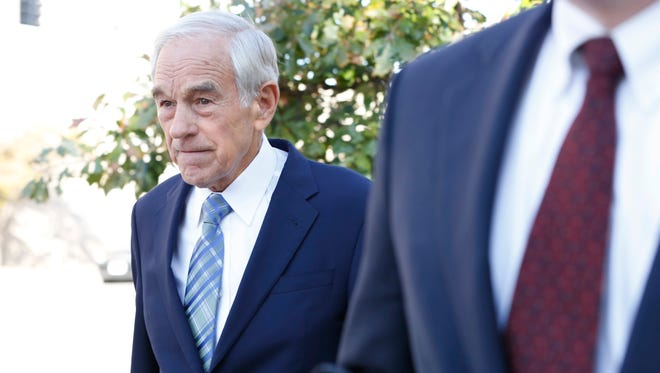 Former Republican presidential candidate Ron Paul (left) walks out of the federal courthouse Wednesday, Oct. 14, 2015 after testifying in the trial of 2012 campaign aides Jesse Benton and Dimitri Kesari in Des Moines.
