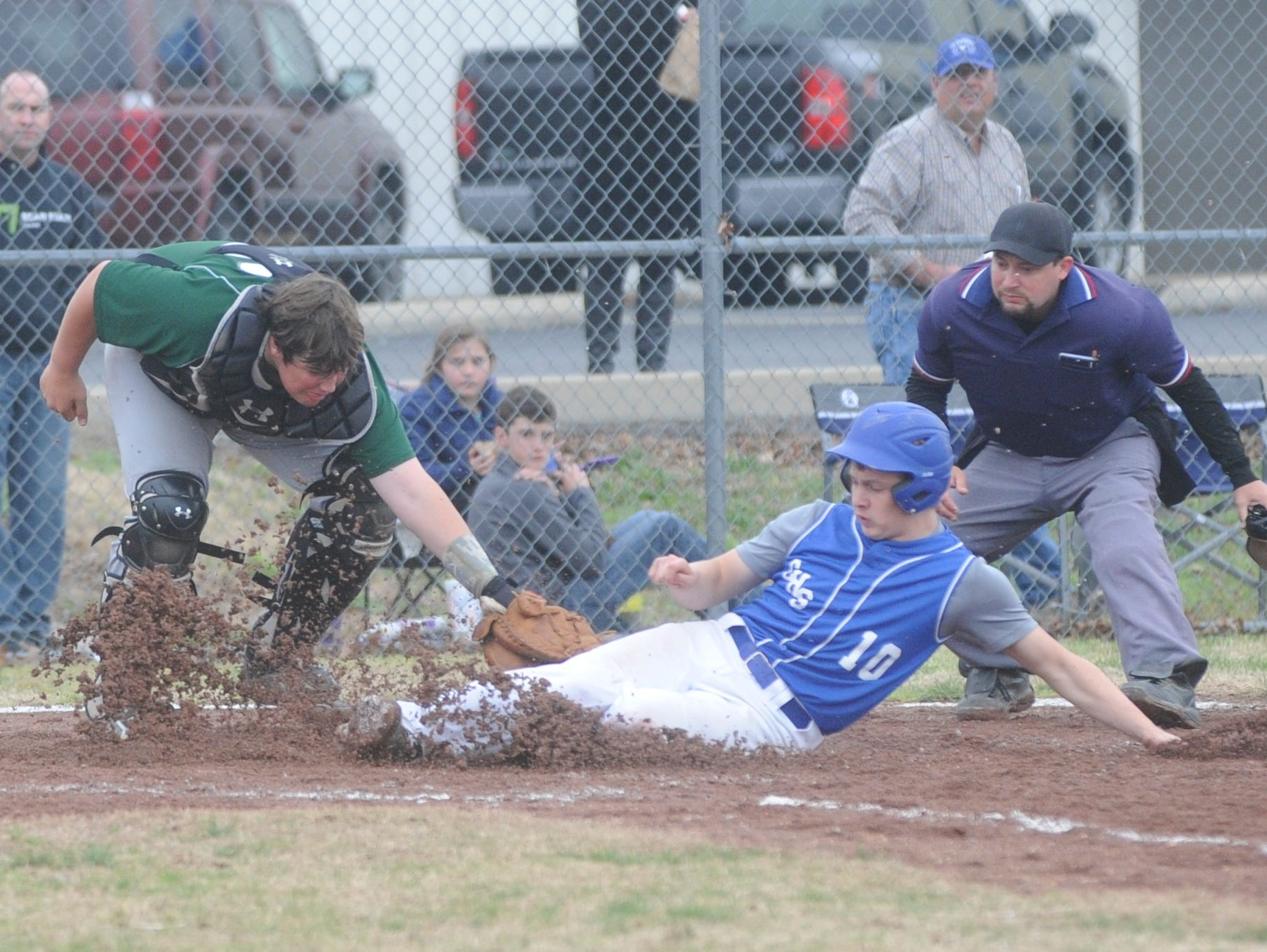Cotter's Shawn White, middle, slides safely into home plate during a game earlier this season against Valley Springs. The Warriors picked up a 3-0 win over Melbourne on Saturday, moving them to the championship game of the 3A Region 3 Tournament at Harrison.