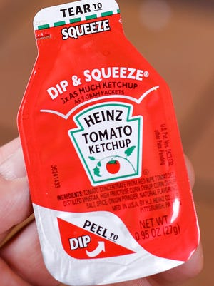 A Michigan inventor is suing H.J. Heinz Co., claiming the company used his patented idea to create Dip & Squeeze ketchup.