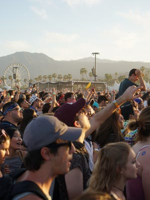 Apr 15, 2017; Indio, CA, USA; A crowd listens to Two Door Cinema Club's final song during the Coachella Valley Music and Arts Festival at Empire Polo Club. Mandatory Credit: Zoe Meyers/The Desert Sun via USA TODAY NETWORK