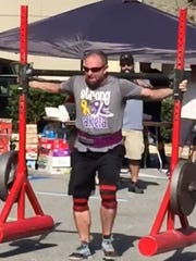 Dennis Walters does a lift during a previous strong man competition. Walters will not compete Saturday.