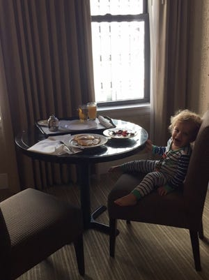 King enjoys room service in Chicago.