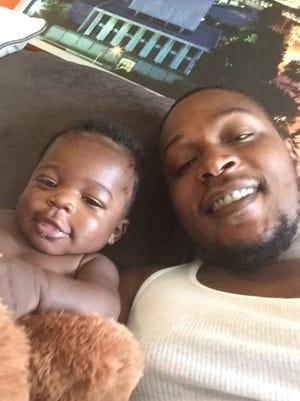 Police have been unable to find Jerome Deshaun Ezell, (right) who they said appeared to leave his 5-month-old son in a car.