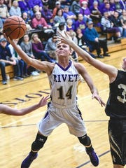 Vincennes Rivet's Grace Waggoner attempts a layup against Washington. The Patriots face Indianpolis Tindey in the semistate Saturday.