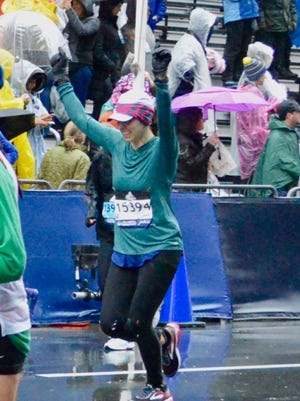 Montgomery's Carlie Ainsworth finishing the Boston Marathon on Monday under difficult weather conditions.