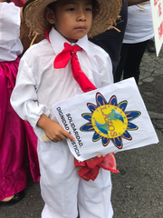 """Pablo Andres Lopez, 5, of New Brunswick holds a sign  that reads """"solidarity, dignity, and justice"""" during an event  Thursday in New Brunswick to launch a 300-mile statewide walk to draw support for legislation that would allow undocumented immigrants to apply for state driver's licenses."""