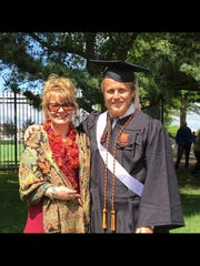 Jenifer Towle, 48, of Washington with her son Evan at his college graduation from Virginia Tech.