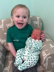 A photo of baby Ryan, at 3 days old, with her older brother Theo, age 2. This photo was taken the day Ryan went to the hospital for jaundice treatment.