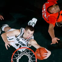 Garrick Sherman pulls down a rebound against Bowling Green's Cameron Black during the second half of an NCAA college basketball game, Saturday, Dec. 4, 2010, in East Lansing, Mich.