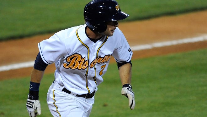 Montgomery Biscuits' Joey Rickard heads to first after hitting a single against the Jacksonville  Suns at Riverwalk Stadium in Montgomery, Ala. on  Monday April 5, 2014.