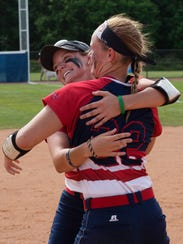 Olivia Clark-Kittleson, left, and Mena Fulton celebrate after winning last year's Super Regional. Now seniors, they're ready to repeat.