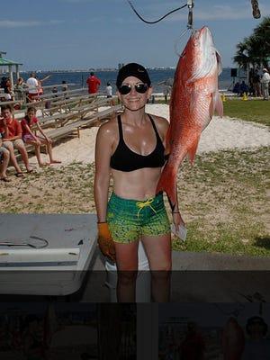 Jennifer Johnson with a 14-1 pound snapper at the Gulf Breeze Sertoma Fishing Rodeo on Saturday, June 11.