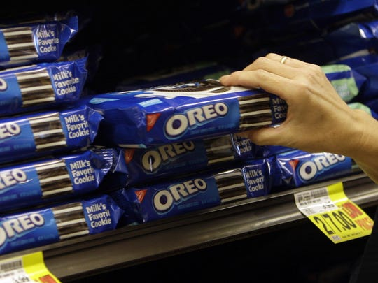 In this Feb. 9, 2011, file photo, a shopper selects Oreo cookies at a Ralphs Fresh Fare supermarket in Los Angeles.