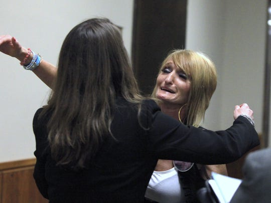 At right, Kym Straton, mother of Mathew Straton, hugs Assistant District Attorney Kelly Wolford after Judge Vincent DiNolfo refused to allow psychiatrist William Lewek to avoid jail by going into a substance abuse treatment program.