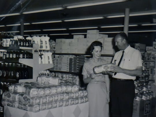 Betty Pratt chats with the Sunbeam Bread representative in an undated photo that hangs in Pratt's Country Store.