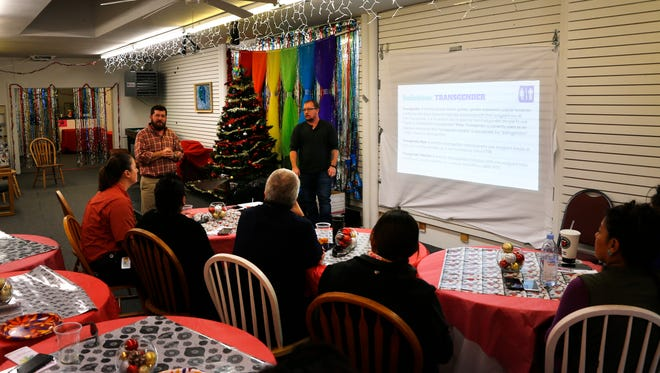 Community members attend a training session led by Transgender Resources Center of New Mexico officials on Wednesday at Identity Inc. in Farmington.