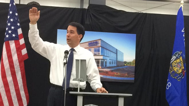 Wisconsin Gov. Scott Walker speaks at H&CS Custom Designed Solutions in Green Bay on Thursday morning.