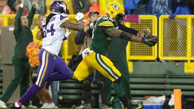 Packers outside linebacker Julius Peppers scores a touchdown against Vikings wide receiver Cordarrelle Patterson after an interception Oct. 2 at Lambeau Field. Will the success of the Peppers signing convince general manager Ted Thompson to delve into free agency?