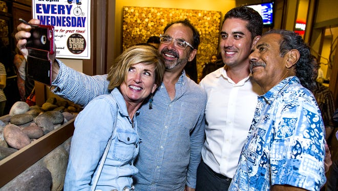 Mesa City Council candidate Ryan Winkle (third from left) takes a selfie with supporters Jen Duff, Ivan Martinez and Zarco Guerrero at Winkle's election night party at the Boulders in Mesa on Tuesday, Aug. 30, 2016.  Ryan is running for the District 3 council seat.