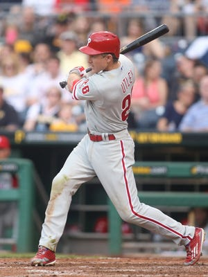 Phillies second baseman Chase Utley singles  June 13 against the Pittsburgh Pirates during the eighth inning at PNC Park. Credit: Charles LeClaire-USA TODAY Sports