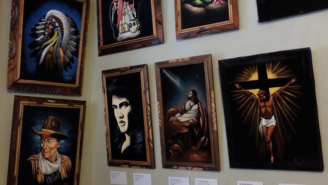 There are lots of iconic and religious displays of black velvet paintings in the Black Velvet: A Rasquache Aesthetic exhibit at Casa de Rosado Saturday, Jan. 13, 2018.