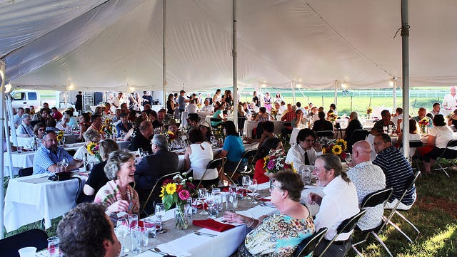 Farmers and consumers gather together to share food and conversation about Wisconsin's diverse food offerings during the Farm to Table event at Voegeli Farms Inc., near Monticello on Aug. 19, 2017.
