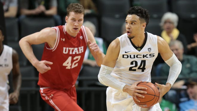 Feb 7, 2016; Eugene, OR, USA; Oregon Ducks forward Dillon Brooks (24) dribbles the ball as Utah Utes forward Jakob Poeltl (42) defends at Matthew Knight Arena. Mandatory Credit: Scott Olmos-USA TODAY Sports