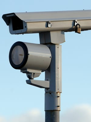 The red-light camera at Walnut and A streets in Wilmington is shown on Thursday. A total of 143 collisions happened in fiscal year 2015 at 31 intersections that have red-light cameras in Wilmington, a new report shows.