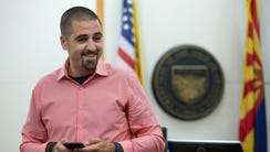 Nick Dugas, 30, is all smiles during an adoption hearing
