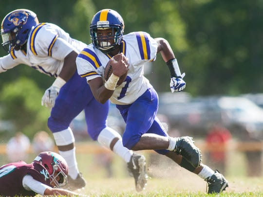 Camden running back Najyere Edwards rushes against Cedar Creek in Saturday's 14-0 win for the Panthers.