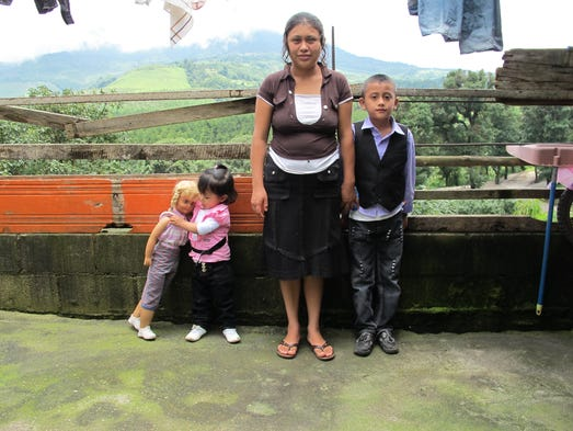 Alicia Gomez, 23, is the last member of her immediate family left in El Rosario, Guatemala in late June 2014. Her brother Jimmy Gomez, now 21, received a U-visa to return to Iowa following the 2008 raid at Agriprocessors in Postville. Alicia's parents and siblings were eligible to join Jimmy in the U.S. under the visa, but she was not due to her age and marital status. She now lives with her husband and kids in her mother-in-law's home.