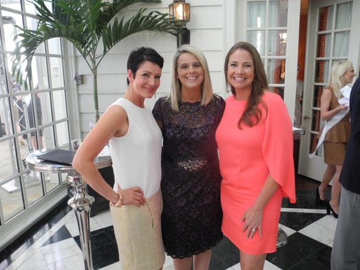 The Swan Ball 2014 Auction co-chairs Lorie Duke, left, Amy Liz Riddick and Jody Hull at The Swan Ball 2014 Auction Party, held at Belle Meade Country Club.