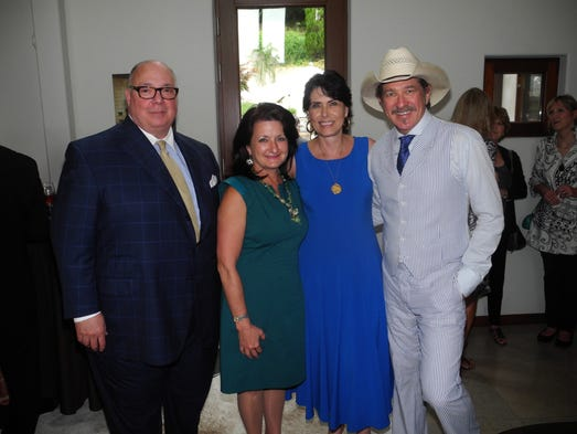 Norman M. Lipman Award recipients Keith and Deby Pitts, left, and Grand Cru hosts Barbara and Kix Brooks at Nashville Wine Auction's l'Ete du Vin Gran Cru, held at the home of Barbara and Kix Brooks.
