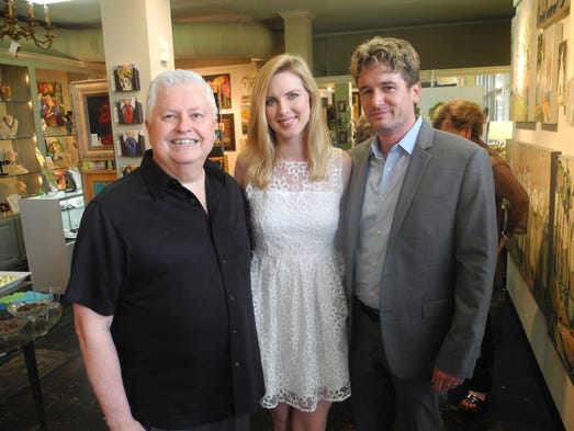 Ron York, left, and Arts & Flowers co-chairs Meagan and Whit Rhodes at the Arts & Flowers Patrons' Preview Party, held at York & Friends Fine Art. Arts & Flowers, an annual fundraising event for ALIAS Chamber Ensemble will be held on July 19 at W.O Smith Music School.