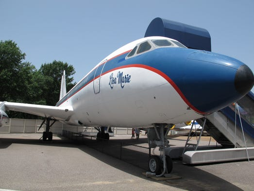 This photo taken on Tuesday, July 1, 2014, shows the Lisa Marie, one of two jets once owned by late singer Elvis Presley, that is used as a tourist exhibit at the Graceland tourist attraction in Memphis, Tenn. The company that operates the Graceland tourist attraction has told the current owners of the Lisa Marie, and another plane called the Hound Dog II, that it wants the planes removed from Graceland by late April 2015, or shortly afterward. (AP Photo/Adrian Sainz)
