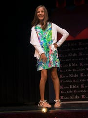 Karen Fernandez, of Laurel Oak Elementary School, models clothes from Lilly Pulitzer.