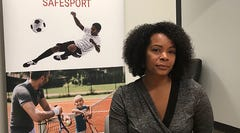Ju'Riese Colon, the CEO for the U.S. Center for SafeSport, talks about the challenges facing her organization at their headquarters in Denver, Monday, Sept. 16, 2019. The center is receiving 55 percent more sex-abuse reports this year than in 2018, leading to a debate over whether the Olympic movement or federal government should shoulder the increasing cost of keeping athletes safe. (AP Photo/Eddie Pells)