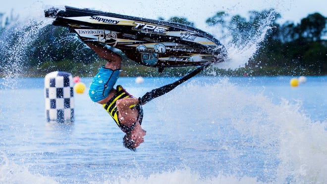 Chris Anyzeski performs a backflip during the Pro Freestyle heat of the Pro Watercross World Championships at Sugden Regional Park in Naples last year. The 2018 championships begin Friday and run through Nov. 4.