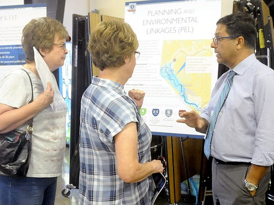Jacobs Engineering Senior Project Manager Bardia Nezhati talks with people about plans for I-11.