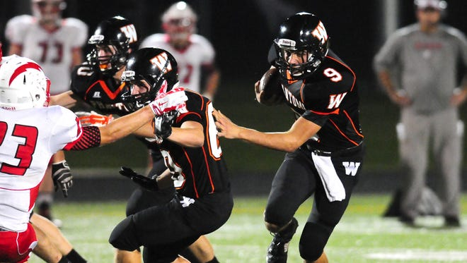 West De Pere quarterback Beau Mommaerts runs against Seymour in Friday's game.