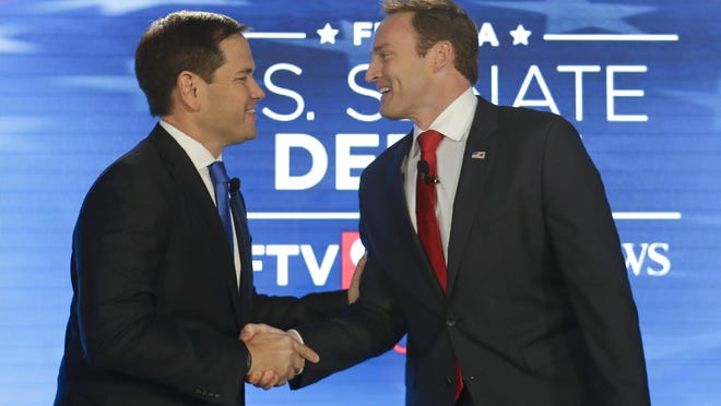 Sen. Marco Rubio, R-West Miami, left, and Rep. Patrick Murphy, D-Jupiter, shake hands before their debate Monday at the University of Central Florida in Orlando.