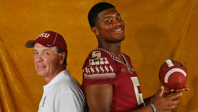 Florida State head coach Jimbo Fisher, left, and quarterback Jameis Winston (5) pose for a photo during the Seminoles' media day.