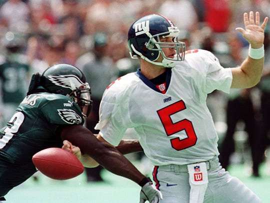 The New York Giants' quarterback Kerry Collins loses his grip on the ball as he is hit by Philadelphia Eagles defensive end Hugh Douglas in a game on Sept. 10, 2000 at Veterans Stadium in Philadelphia. Douglas, a Mansfield Senior graduate, was inducted into the Black College Football Hall of Fame last weekend.